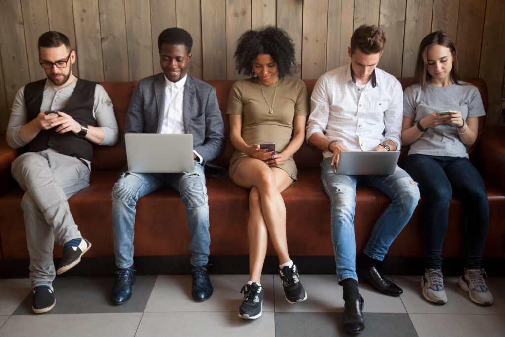 group of young business people sitting on couch