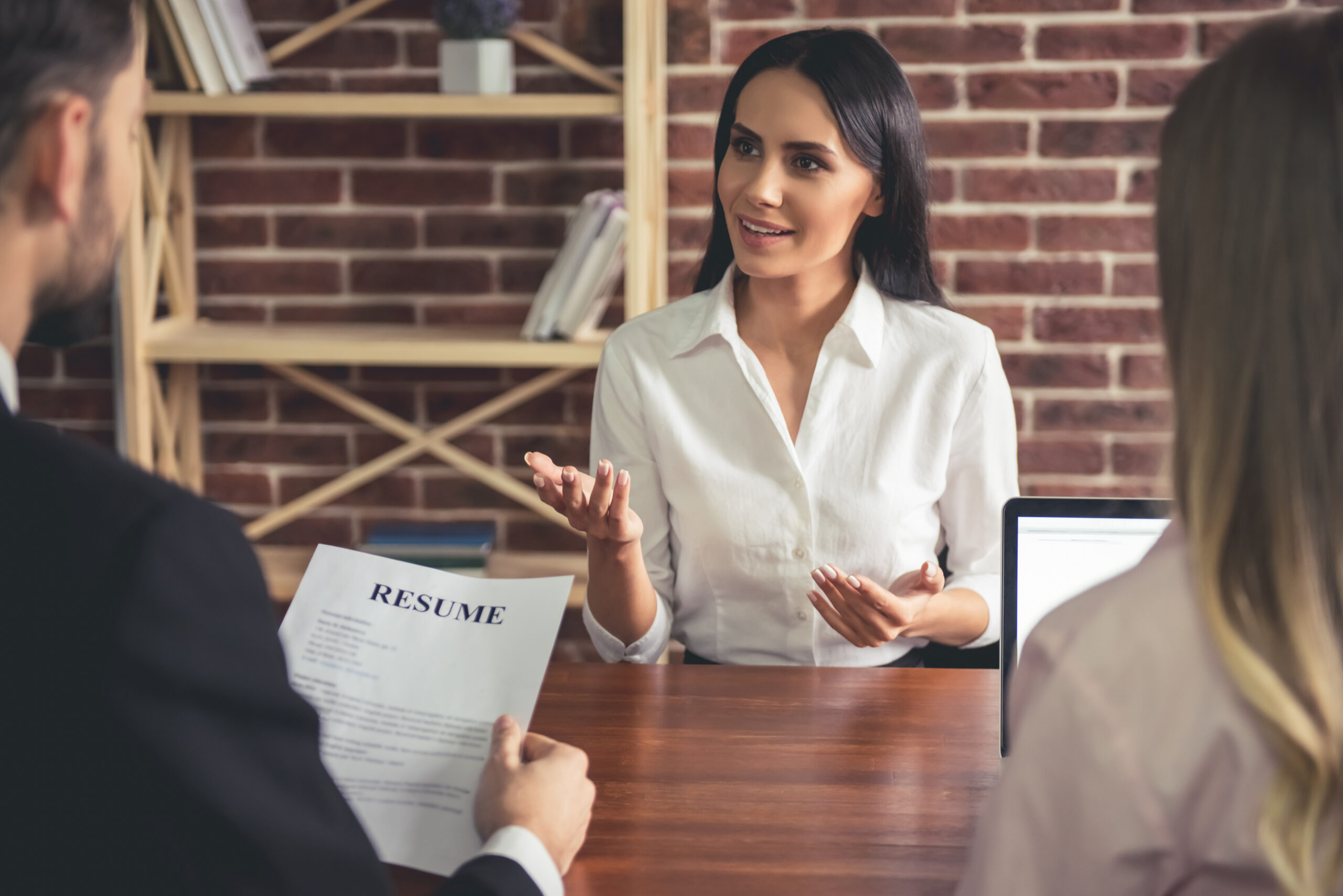 woman interviewing for job with two people