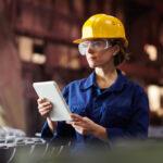 site supervisor factory woman worker hard hat automotive
