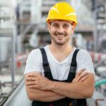general labourer man in yellow hard hat