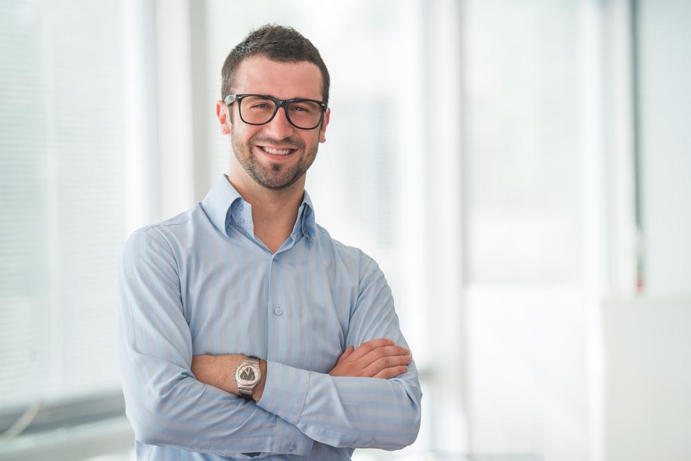manager businessman at work smiling