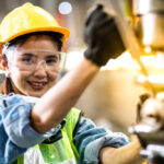 machine operator woman on factory assembly line