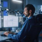 engineer programmer robot designer man at drafting program computer