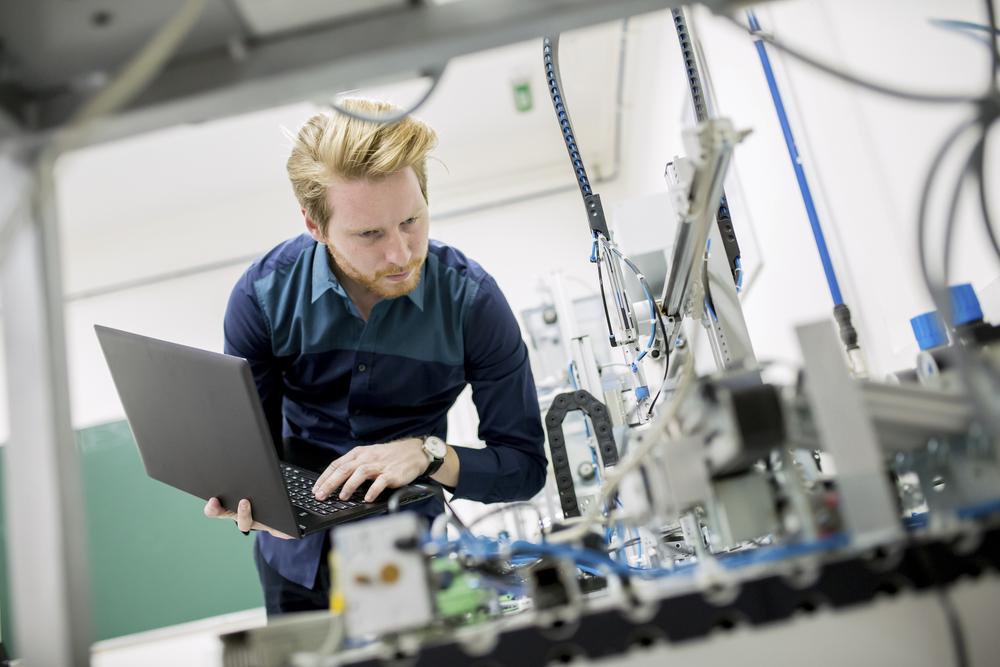 Robot engineer in factory